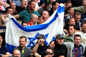 Ajax fans hold an Israeli flag in the stands during the Champions League semifinal first leg at the Tottenham Hotspur Stadium in London on April 30.