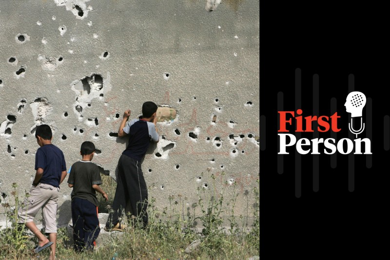 Palestinian children inspect a bullet-riddled wall in Gaza City on April 16, 2008, following an Israeli military operation. MOHAMMED ABED/AFP/Getty Images