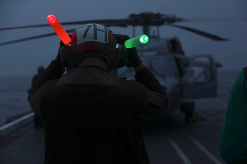 "MH-60S Sea Hawk helicopters assigned to the ""Dusty Dogs"" of Helicopter Sea Combat Squadron 7, attached to Carrier Strike Group 12 and the Nimitz-class aircraft carrier USS Abraham Lincoln, are recalled to Naval Station Norfolk on September 15, 2018. (Jeff Sherman/U.S. Navy via Getty Images)"