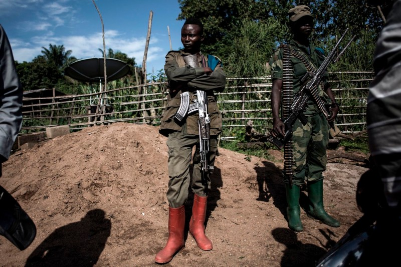 Members of the Armed Forces of the Democratic Republic of the Congo stand guard after an alleged attack by the Allied Democratic Forces rebels in Beni on Nov. 11, 2018.