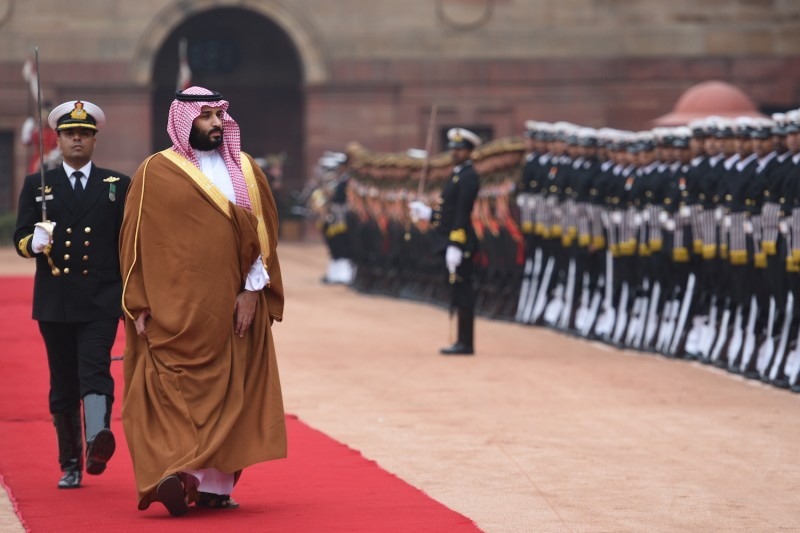 Mohammed bin Salman, the crown prince of Saudi Arabia, inspects an honor guard in New Delhi on Feb. 20.