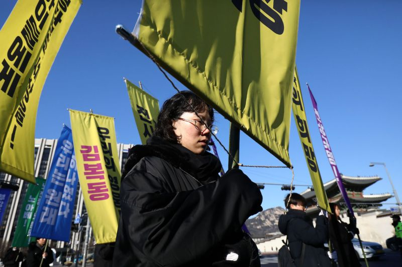 South Koreans participate in a funeral service for Kim Bok-dong, 92, a former so-called comfort woman, in Seoul on Feb. 1.