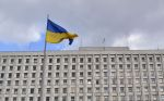A Ukrainian flag flies in front of the Ukrainian Central Election Commission in Kiev on March 12.