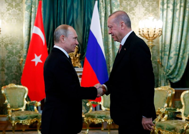 Russian President Vladimir Putin shakes hands with Turkish President Recep Tayyip Erdogan ahead of a meeting at the Kremlin in Moscow on April 8.