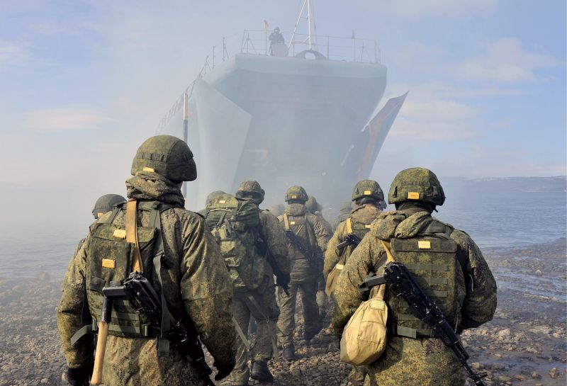 Soldiers board an amphibious warfare ship on the Barents Sea shore in western Arctic Russia on April 17.