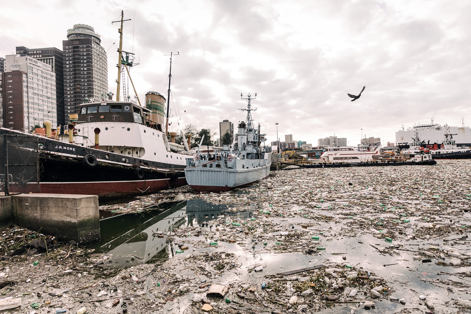 Tons of debris, mostly plastic and wood, swamped the Port of Durban, South Africa, on April 28. The port authority has commenced a major clean-up to remove the large volume of waste and vegetation after recent heavy rains and flooding.  RAJESH JANTILAL/AFP/Getty Images