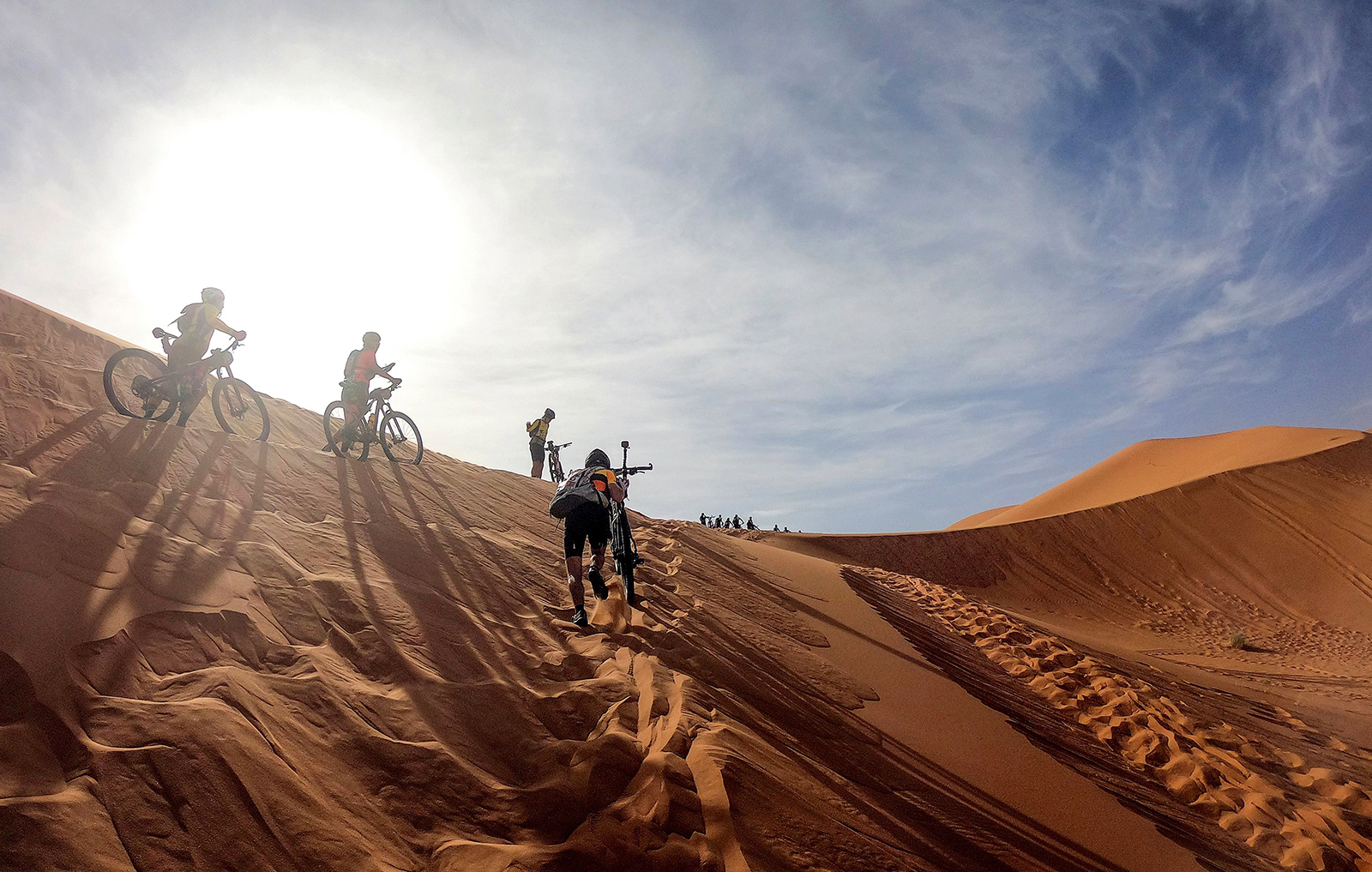 Competitors climb a sand dune during Stage 1 of the Titan Desert 2019 mountain biking race around Merzouga in Morocco on April 28. FRANCK FIFE/AFP/Getty Images