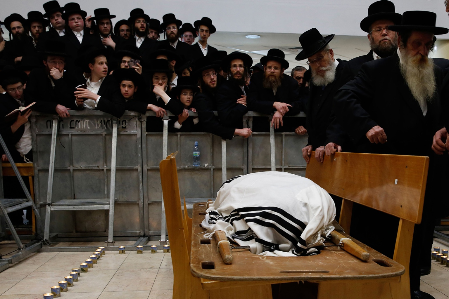 Ultra Orthodox Jewish men attend the funeral of Hassidic Rabbi Menahem Mendel Taub, who died at the age of 96, in Jerusalem on April 28. Thousands attended the funeral for the Holocaust survivor known for his especially brutal treatment at the hands of the Nazis and his efforts to memoialize the genocide's victims. GIL COHEN-MAGEN/AFP/Getty Images