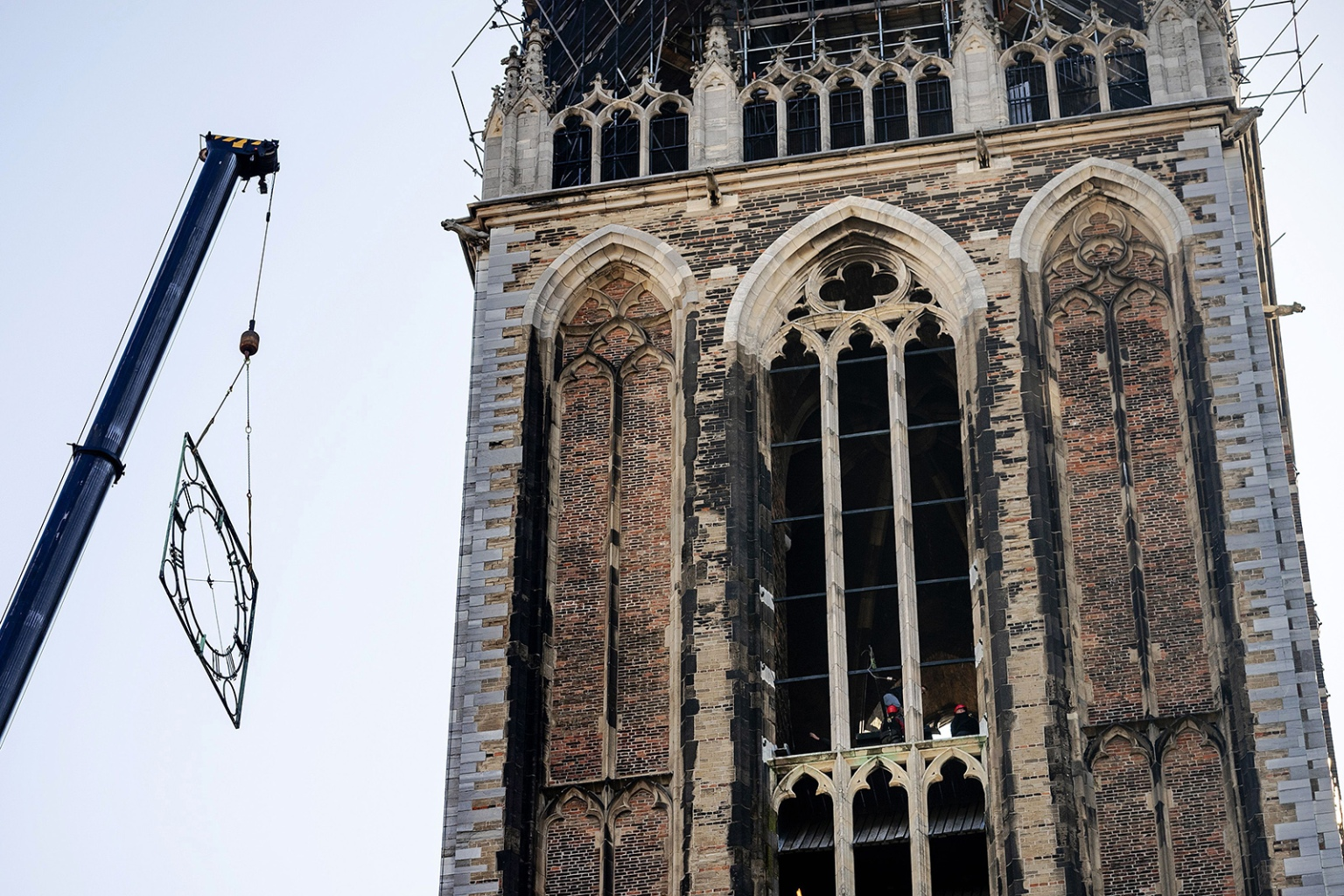 A crane removes a clock frame from the Dom Tower in Utrecht on April 29 ahead of a long period of restoration of the monument. ROBIN VAN LONKHUIJSEN/AFP/Getty Images
