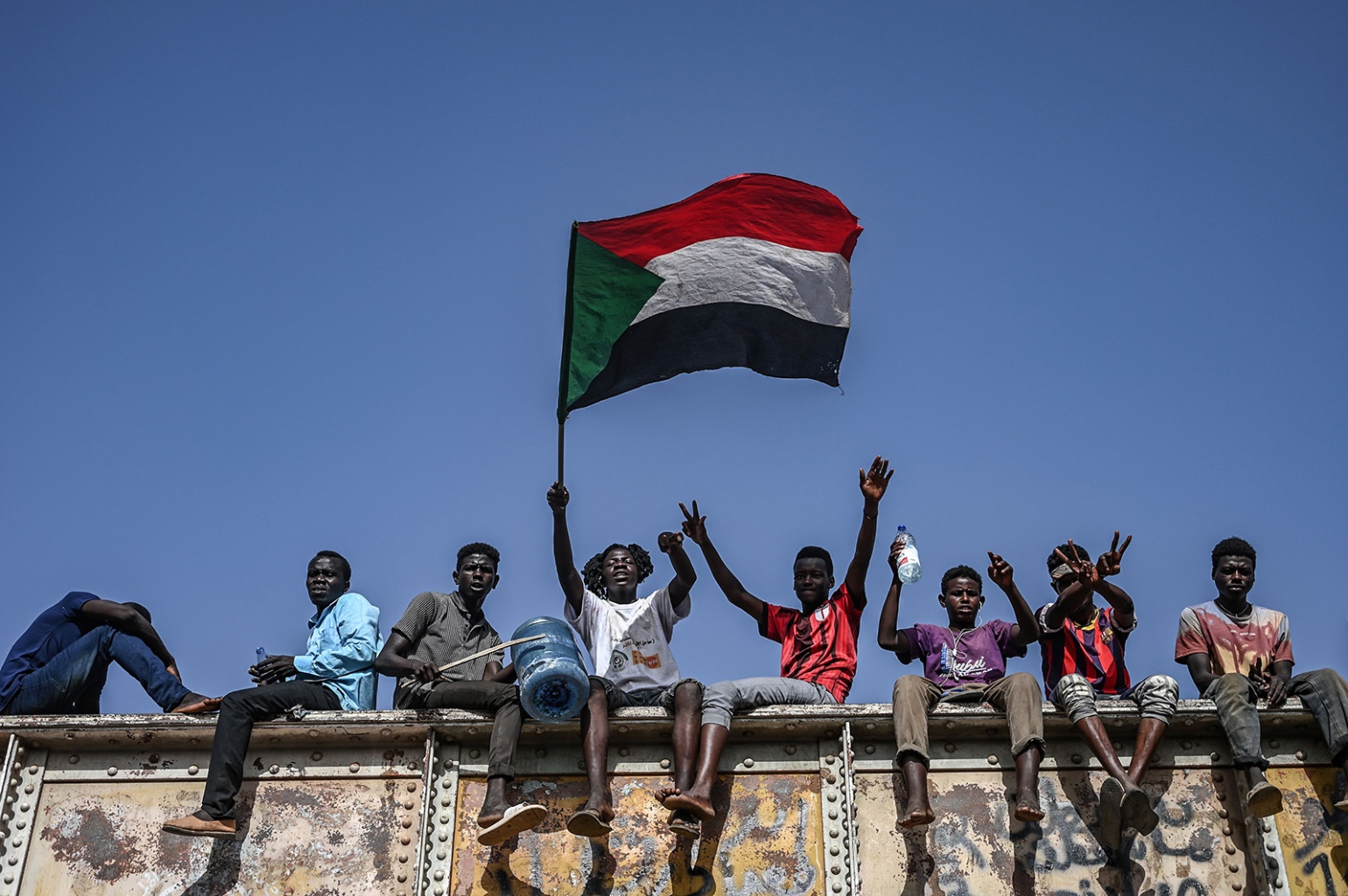 Sudanese protesters fly their national flag during a sit-in outside the army headquarters in Khartoum on April 29. OZAN KOSE/AFP/Getty Images