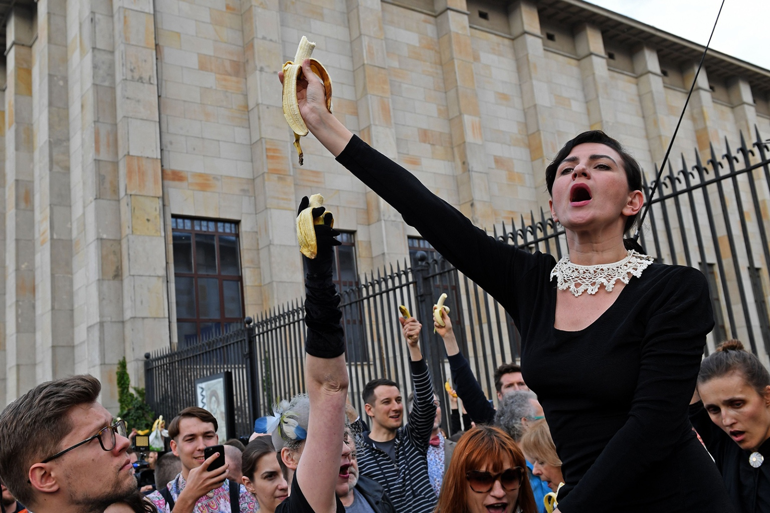 People with bananas demonstrate outside Warsaw's National Museum on April 29, to protest against censorship, after authorities removed an artwork at the museum presenting a woman eating a banana, saying it was improper. JANEK SKARZYNSKI/AFP/Getty Images