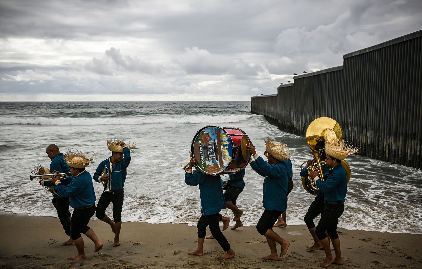 Mexican traditional musicians from Oaxaca State play music and dance on the beach at Playas de Tijuana in Tijuana near a section of the U.S.-Mexico border fence on April 29. RONALDO SCHEMIDT/AFP/Getty Images