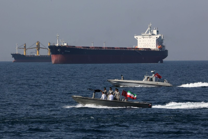 Iranian forces take part in National Persian Gulf Day in the Strait of Hormuz on April 30. Iran has repeatedly threatened to close the crucial waterway as a riposte to U.S. pressure.