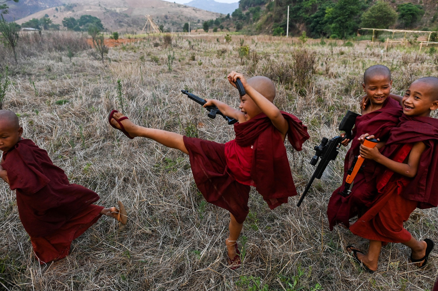 Buddhist novices play with toy guns during the rocket festival in Nantar Shan state in Myanmar on April 28. Myanmar's ethnic Pa'O fire huge, homemade rockets into the sky during an annual call for plentiful rains and a chance for a windfall of cash. YE AUNG THU/AFP/Getty Images