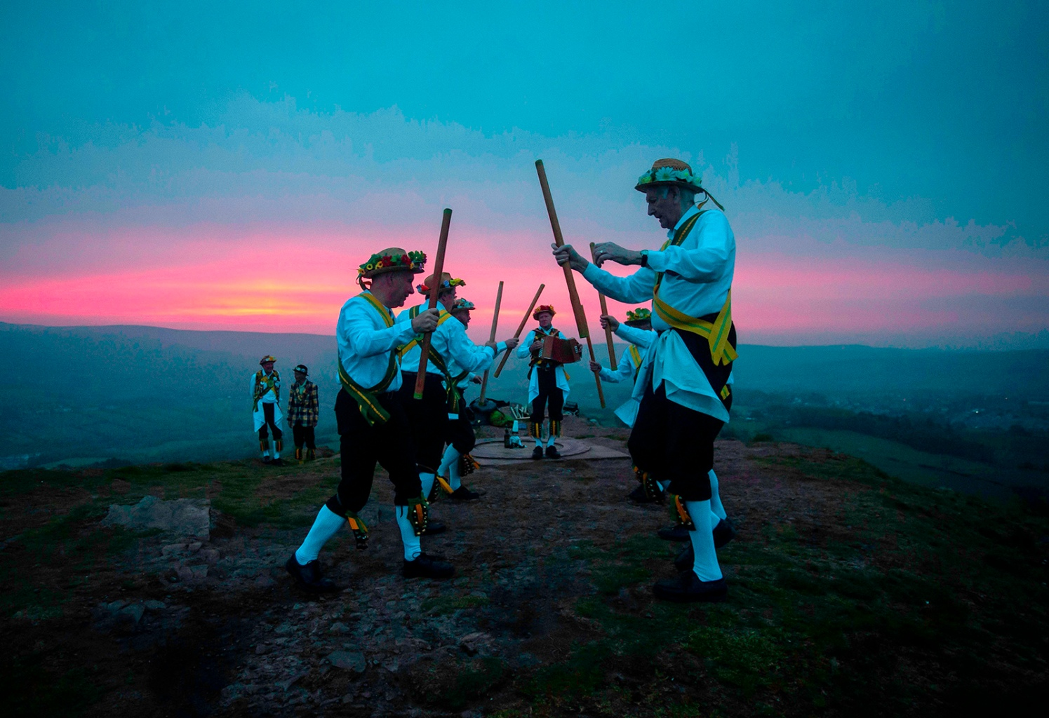 Members of the Chapel-en-le-Frith Morris Dancers dance atop the Eccles Pike at High Peak in Derbyshire, England, before sunrise on May 1. The dancers perform annually at the peak as part of the ancient Celtic festival Beltane, celebrated on May Day or the beginning of summer. LINDSEY PARNABY/AFP/Getty Images