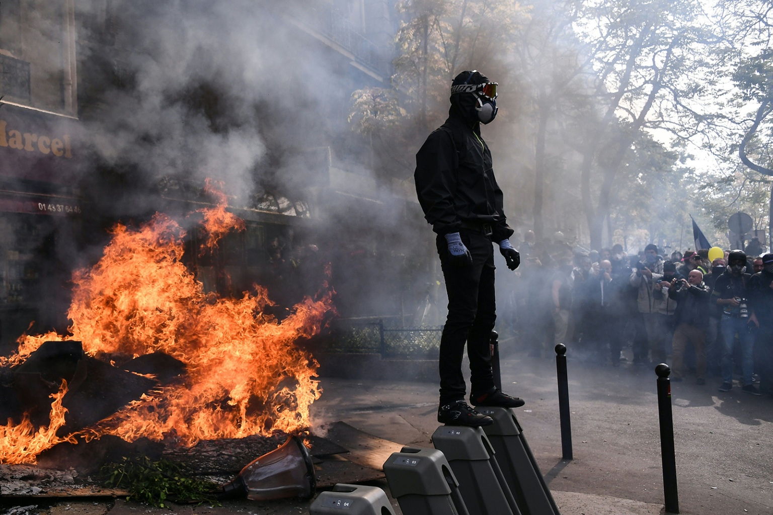 A masked protester stands next to a burning barricade during clashes with police at a May Day demonstration in Paris on May 1. ANNE-CHRISTINE POUJOULAT/AFP/Getty Images