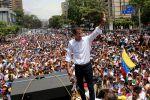 Venezuelan opposition leader Juan Guaidó waves at his supporters during a demonstration at Avenida Francisco de Miranda on May 1 in Caracas.