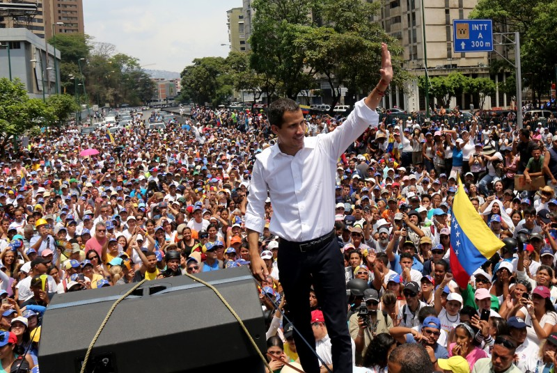 Venezuelan opposition leader Juan Guaidó waves at his supporters during a demonstration at Avenida Francisco de Miranda on May 1 in Caracas.
