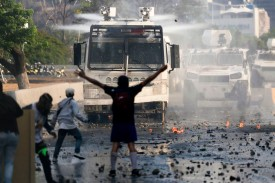 Anti-government protesters clash with security forces in Caracas during the commemoration of May Day on May 1.