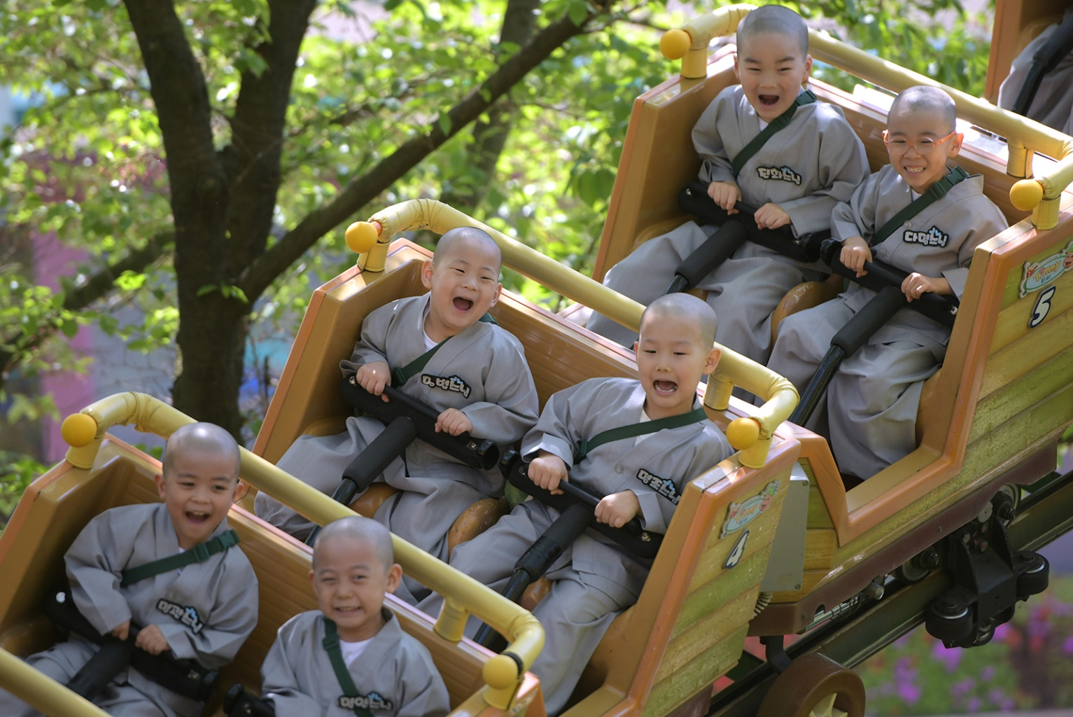 South Korean children ride a roller coaster as they visit an amusement and animal park during their training program to learn about Buddhism in Yongin, south of Seoul, on May 2. JUNG YEON-JE/AFP/Getty Images