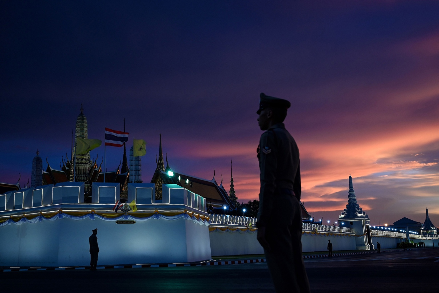 Royal Thai police stand guard near the Grand Palace in Bangkok on May 3 ahead of Thailand's King Maha Vajiralongkorn's coronation which will take place from May 4 to 6. MANAN VATSYAYANA/AFP/Getty Images