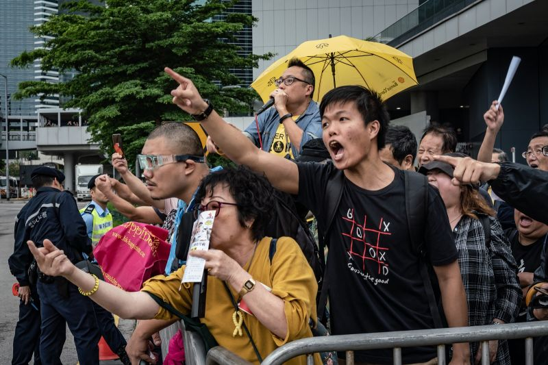 Protesters hold placards and shout slogans as they take part in a rally against the extradition law outside the Legislative Council building in Hong Kong on May 4.
