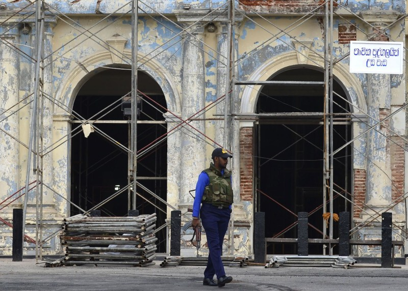 A Sri Lankan soldier stands guard outside St. Anthony's Shrine in Colombo on May 5, two weeks after a series of bomb blasts targeting churches and luxury hotels killed 257 people.