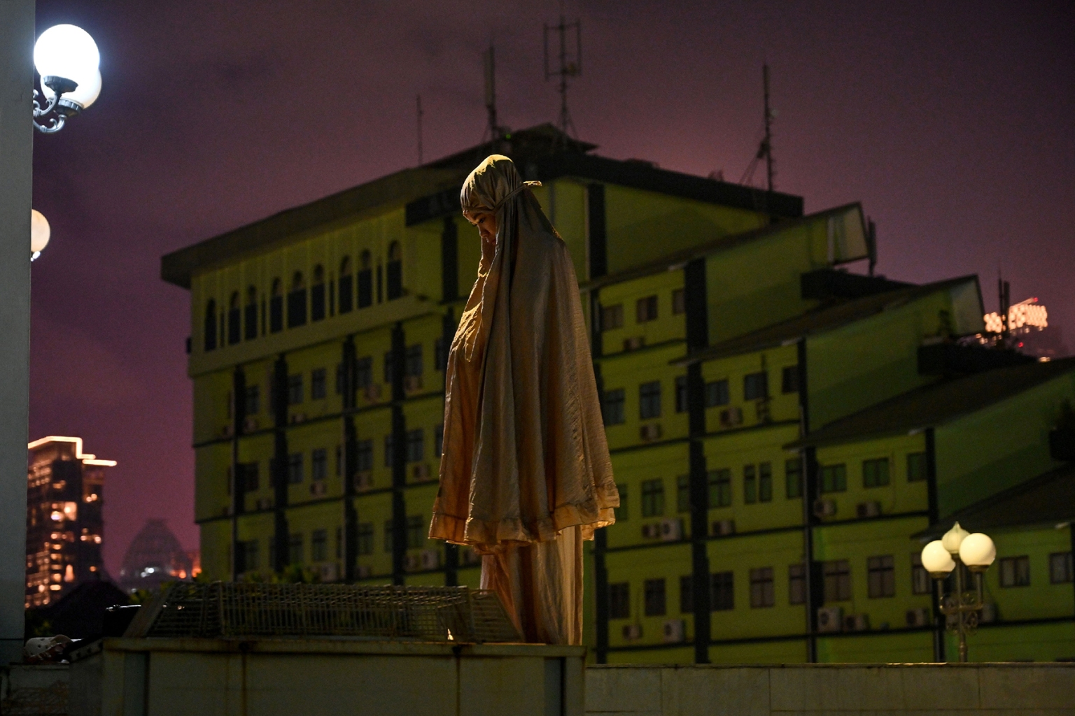 An Indonesian Muslim woman prays on a terrace of the Al-Azhar mosque during the holy month of Ramadan in Jakarta on May 6. ADEK BERRY/AFP/Getty Images