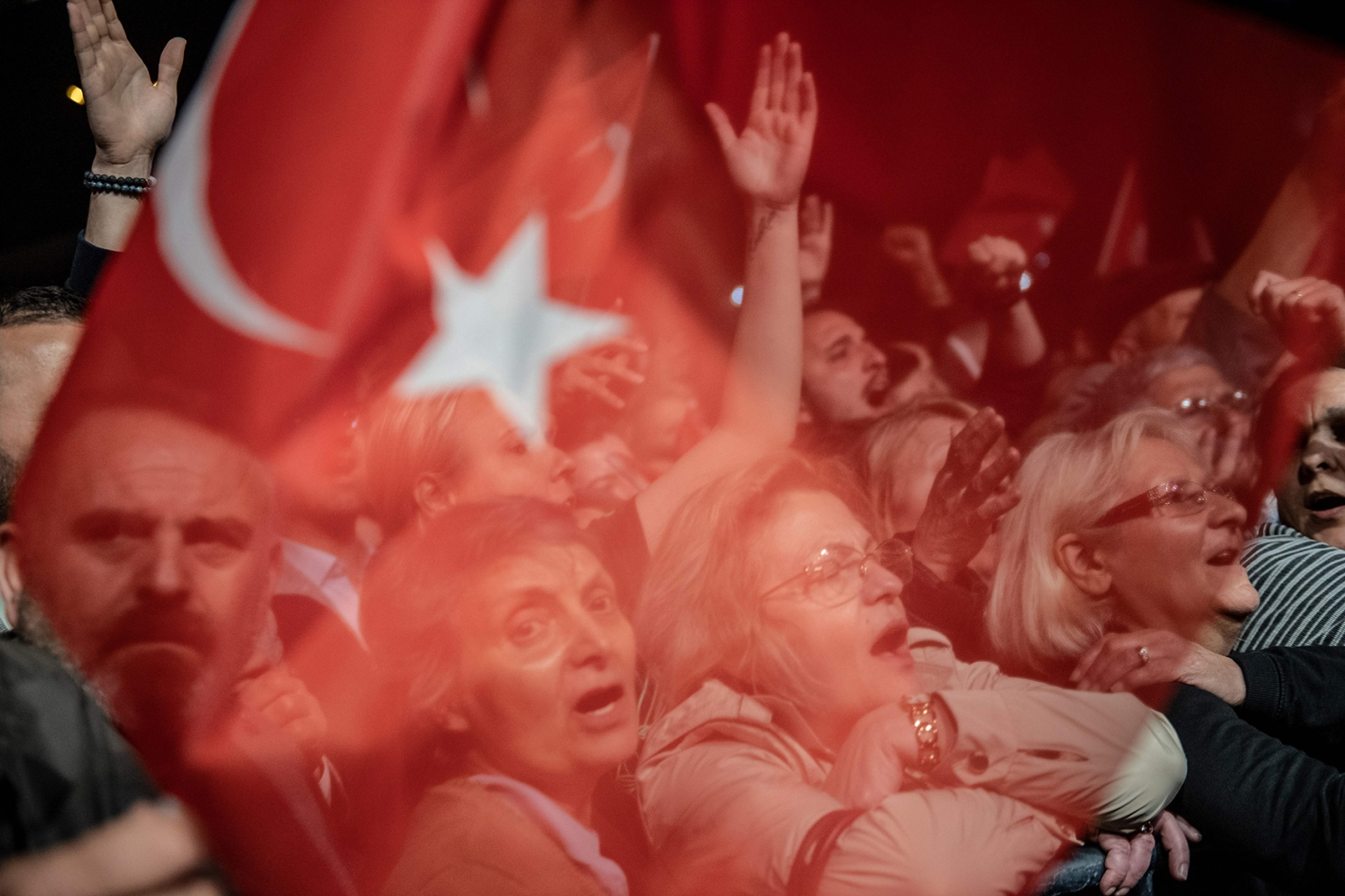 Supporters of Istanbul Mayor Ekrem Imamoglu react as they wait for him during a protest against the re-run of the city's mayoral election in Istanbul on May 6. BULENT KILIC/AFP/Getty Images