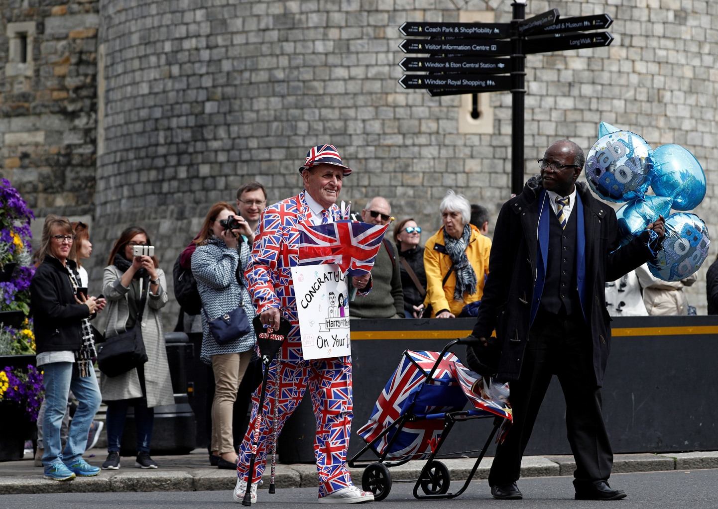 A royal well-wisher walks outside Windsor Castle in Windsor, west of London, on May 7, the day after the announcement that Britain's Meghan, Duchess of Sussex had given birth to a son. ADRIAN DENNIS/AFP/Getty Images