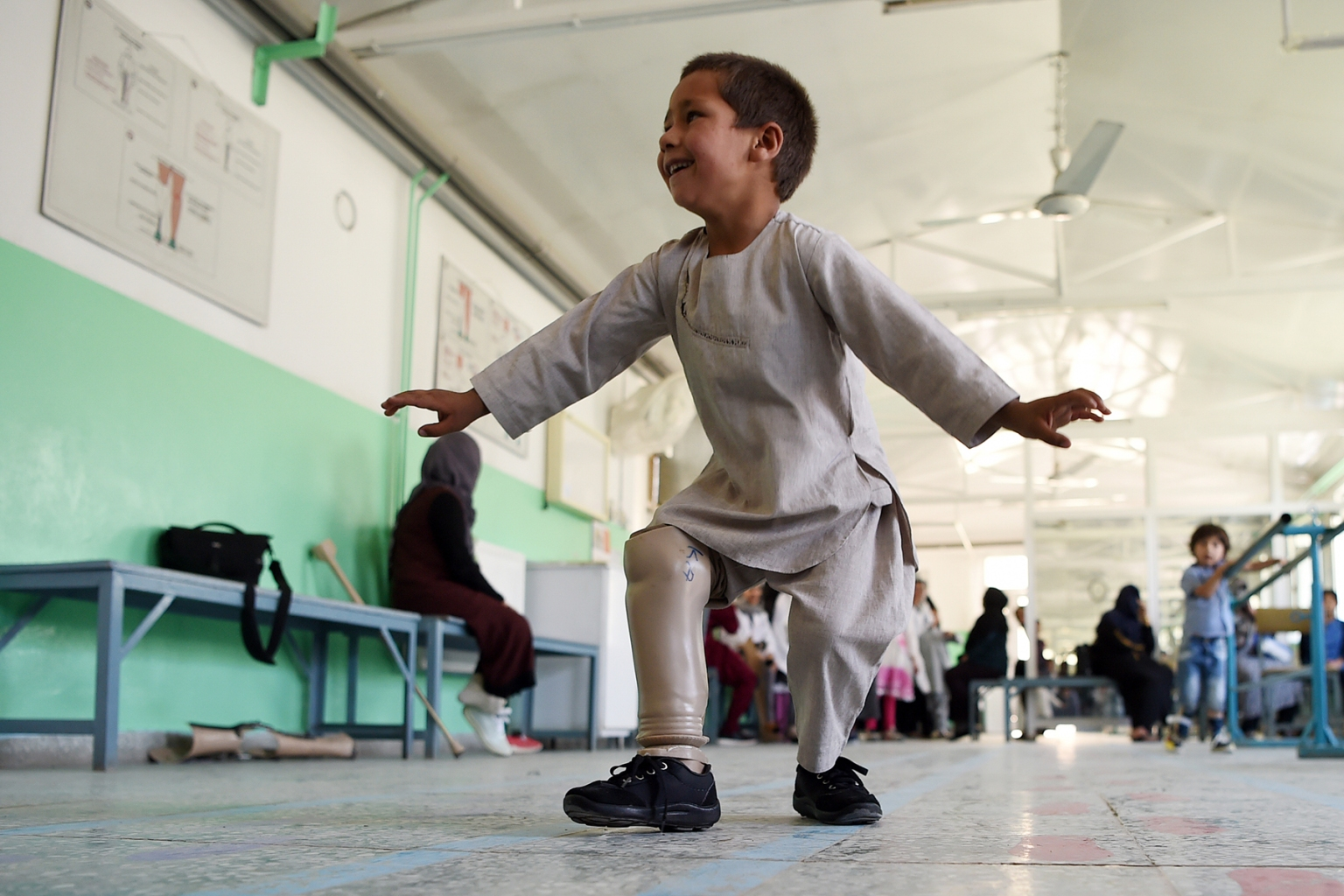 Ahmad Sayed Rahman, a 5-year-old Afghan boy who lost his right leg when he was hit by a bullet in the crossfire of a battle, dances with his prosthetic leg at the International Committee of the Red Cross hospital for war victims and the disabled in Kabul on May 7. WAKIL KOHSAR/AFP/Getty Images