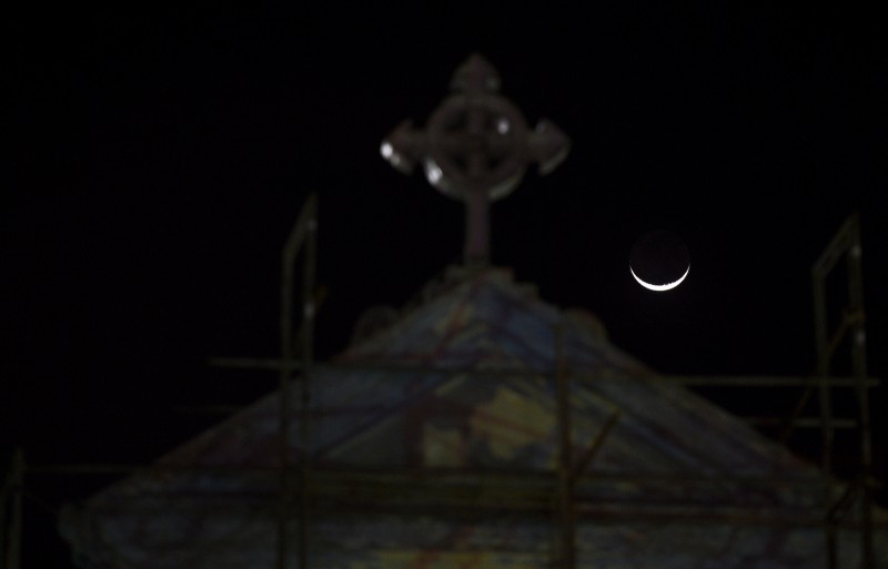 A crescent moon is seen over St Anthony's church after it was partially opened for the first time since the Easter Sunday attacks in Colombo on May 7, 2019.