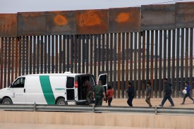 Migrants board a U.S. Customs and Border Protection van after being detained at the border in Ciudad Juárez, Mexico, on May 7.