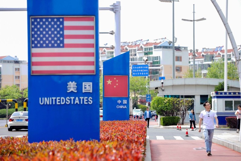 U.S. and Chinese flags at the Qingdao free trade port area in China's Shandong province on May 8.