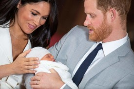 Britain's Prince Harry, Duke of Sussex, and his wife Meghan, Duchess of Sussex, pose for a photo with their newborn baby son, Archie Harrison Mountbatten-Windsor, in St George's Hall at Windsor Castle in Windsor, west of London on May 8, 2019.