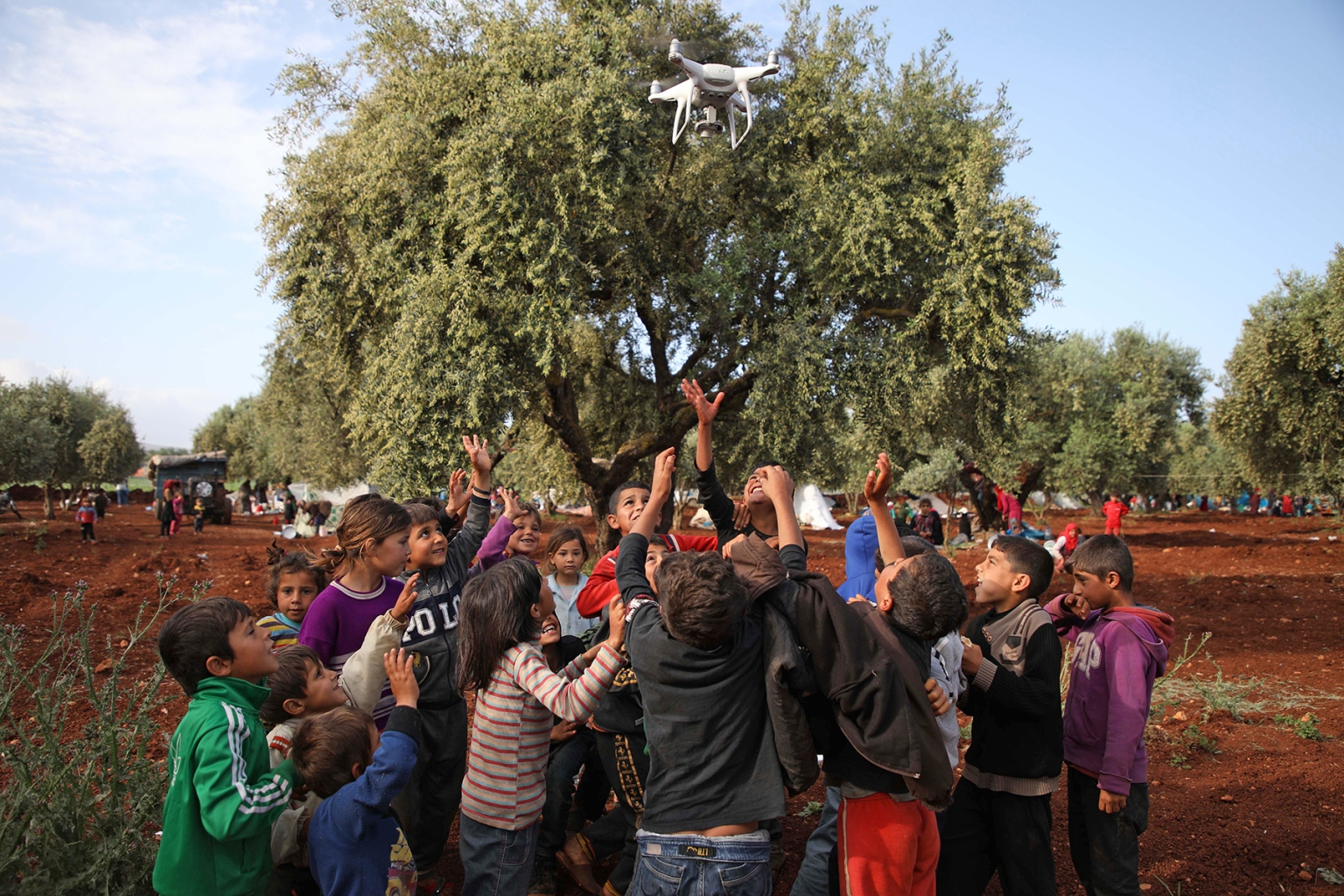 Displaced Syrian children play with a drone in a field near a camp for displaced people in the village of Atme in the jihadist-held northern Idlib province on May 8. AAREF WATAD/AFP/Getty Images
