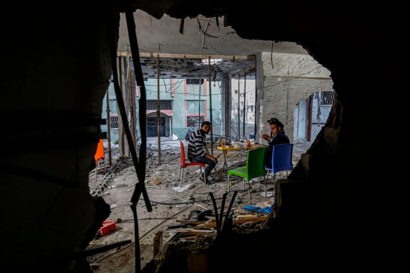 Palestinian amputees break their fast at a community center that was destroyed during the two-day escalation, in Rafah in the southern Gaza Strip on May 8.