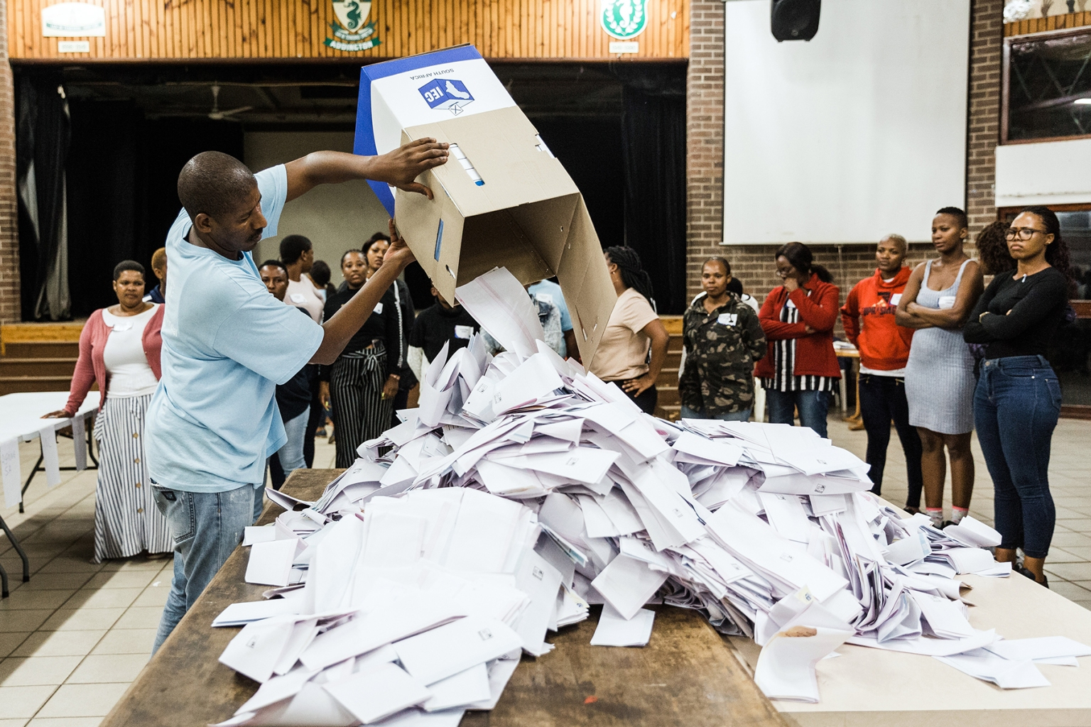 An Independent Electoral Officer opens a ballot box as counting begins at the Addington Primary School after voting in the sixth national general elections in Durban, South Africa, on May 8. RAJESH JANTILAL/AFP/Getty Images