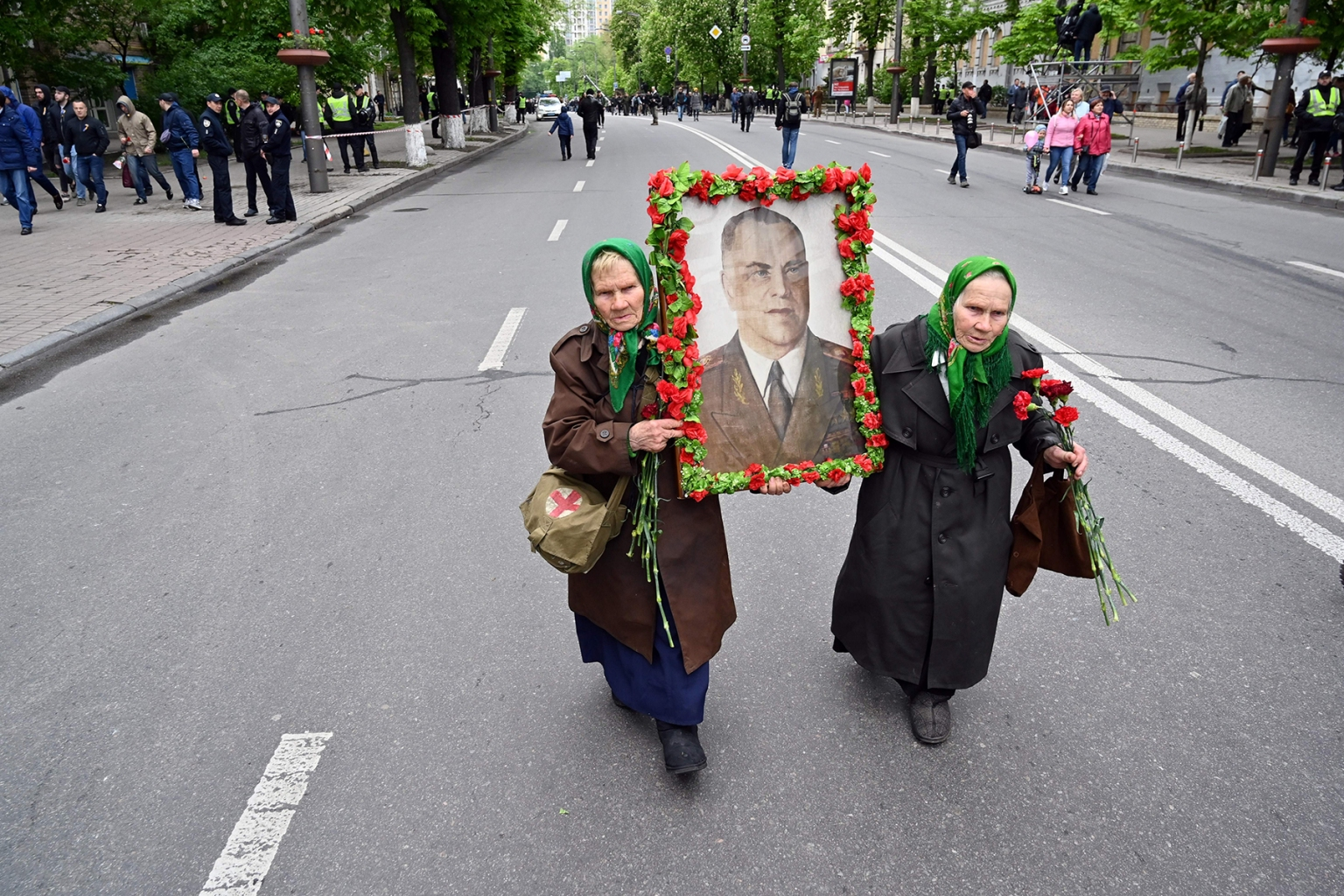 Twin sisters carry a portrait of Georgy Zhukov, marshal and commander of the Soviet Army, as they take part in Victory Day celebrations in Kiev, Ukraine, on May 9. SERGEI SUPINSKY/AFP/Getty Images