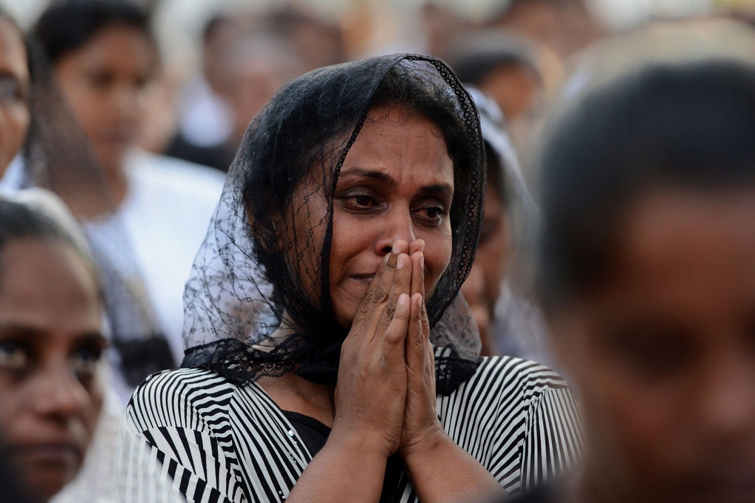 A Sri Lankan Christian cries as she prays during a Mass outside St Sebastian's Church after it was partially opened for the first time since the Easter Sunday attacks in Negombo on May 9. ISHARA S. KODIKARA/AFP/Getty Images