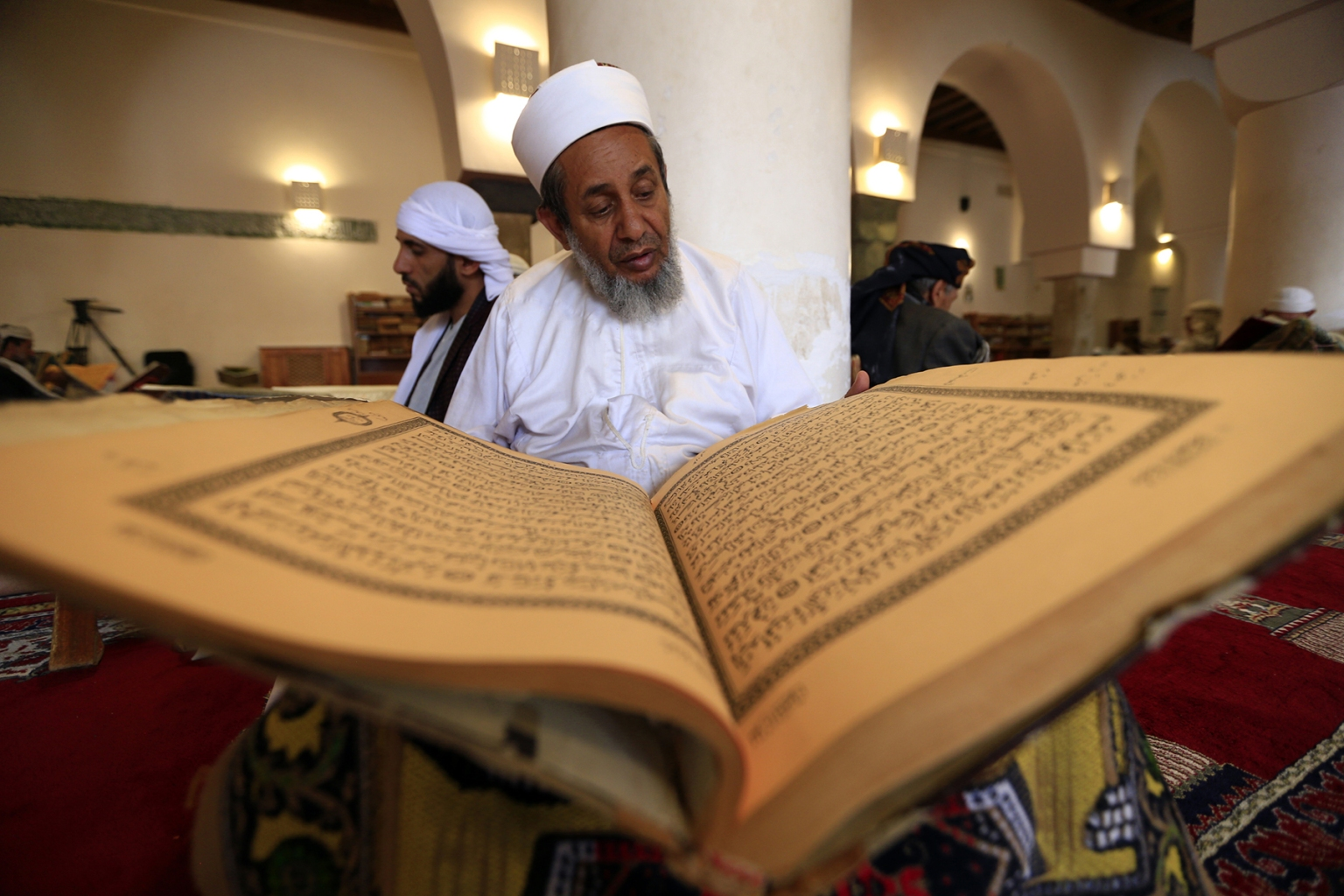 A Yemeni man reads the Quran at the Great Mosque in the old city of the capital Sanaa during Ramadan on May 9. MOHAMMED HUWAIS/AFP/Getty Images
