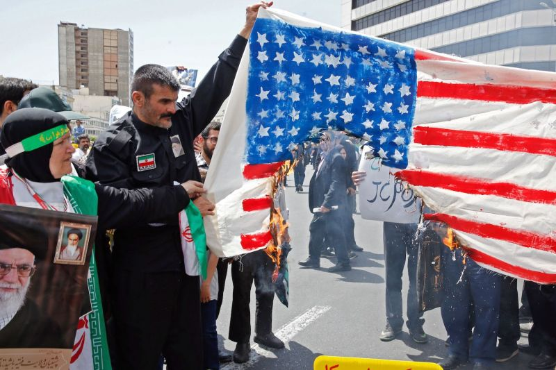 Demonstrators burn a makeshift U.S. flag during a rally in Tehran on May 10.