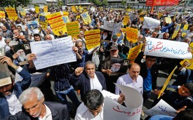 Iranian demonstrators raise placards as they chant anti-US slogans during a rally in Tehran on May 10.