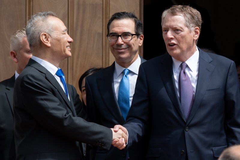 Chinese Vice Premier Liu He shakes hands with U.S. Trade Representative Robert Lighthizer alongside U.S. Treasury Secretary Steven Mnuchin after trade talks between the two countries broke down on May 10.