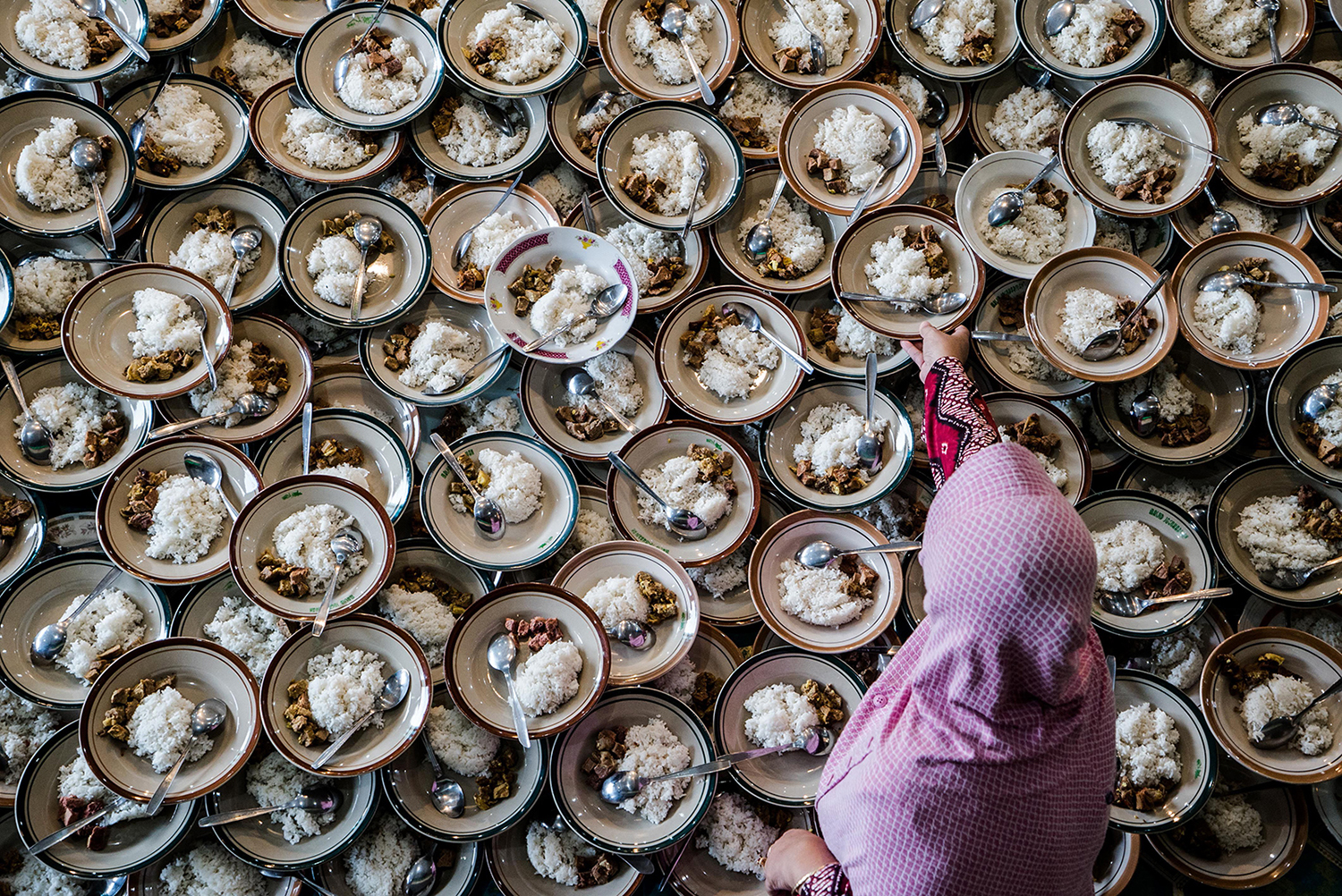 An Indonesian woman prepares meals for Muslims breaking their fast during the holy month of Ramadan at Jogokariyan Mosque in Yogyakarta on May 11. OKA HAMIED/AFP/Getty Images