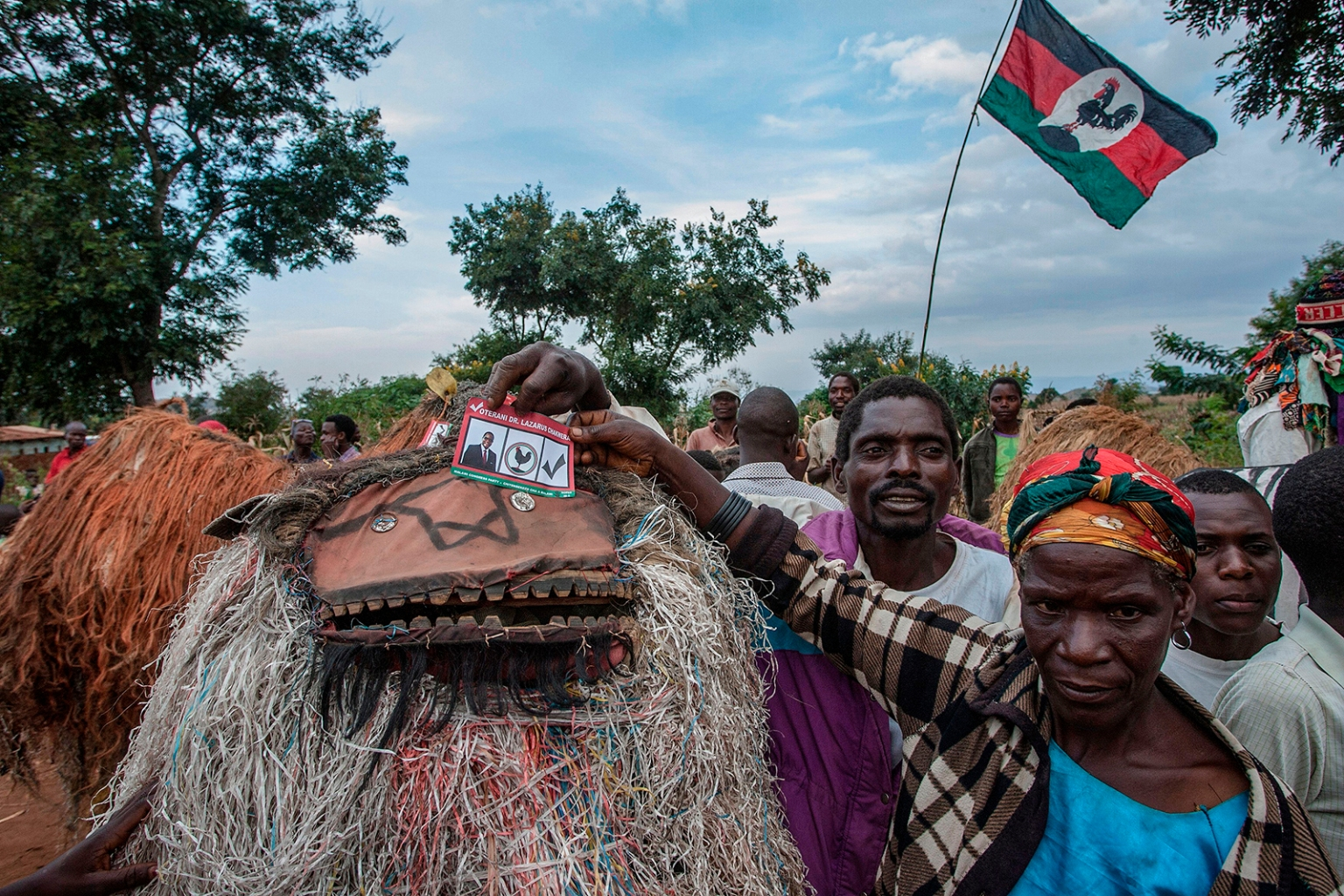 A female village chief and incharge of the Gulewamkulu dance holds a dummy ballot paper urging people to vote for Lazarus Chakwera, leader of the Malawi Congress Party, the main Malawi opposition party, during a campaign rally in Lilongwe on May 12, ahead of Malawi's general election. AMOS GUMULIRA/AFP/Getty Images