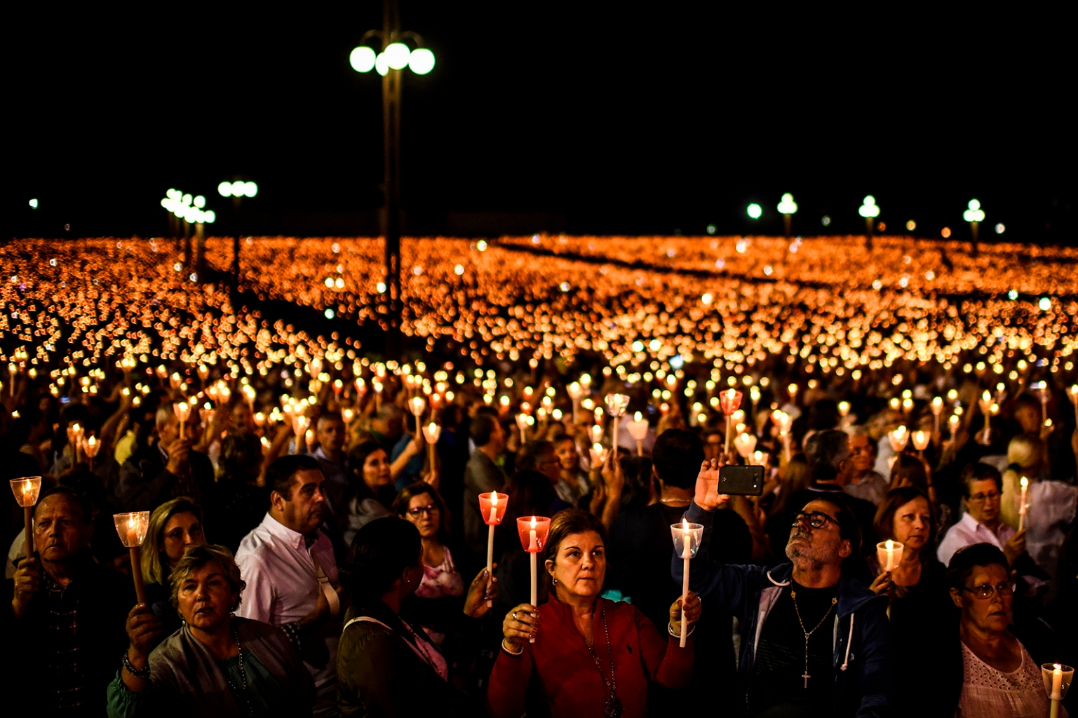 Pilgrims hold candles as they pray during the candle procession at the Fatima shrine in Fatima, central Portugal, on May 12. Thousands of pilgrims converged on the shrine to celebrate the anniversary of Fatima's miracle when three shepherd children claimed to have seen the Virgin Mary in May 1917. PATRICIA DE MELO MOREIRA/AFP/Getty Images