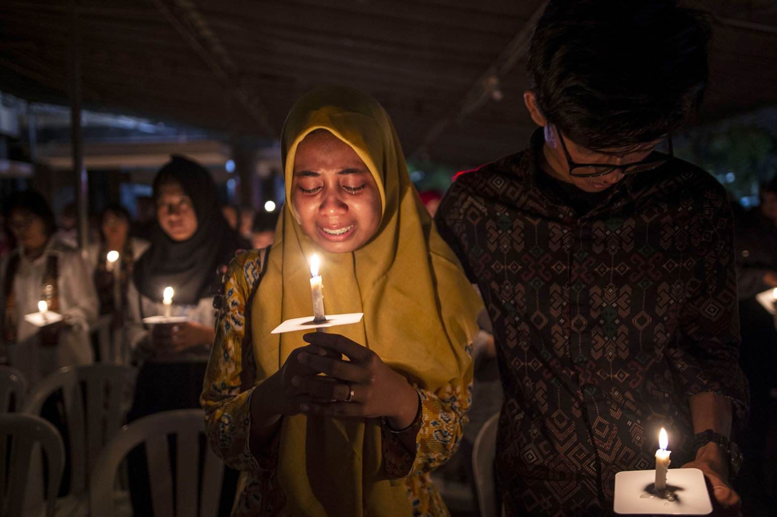 Indonesian Muslims gather during a candlelight vigil to remember the victims of deadly suicide bombings carried out one year ago, outside the Saint Mary Catholic Church in Surabaya on May 13. JUNI KRISWANTO/AFP/Getty Images