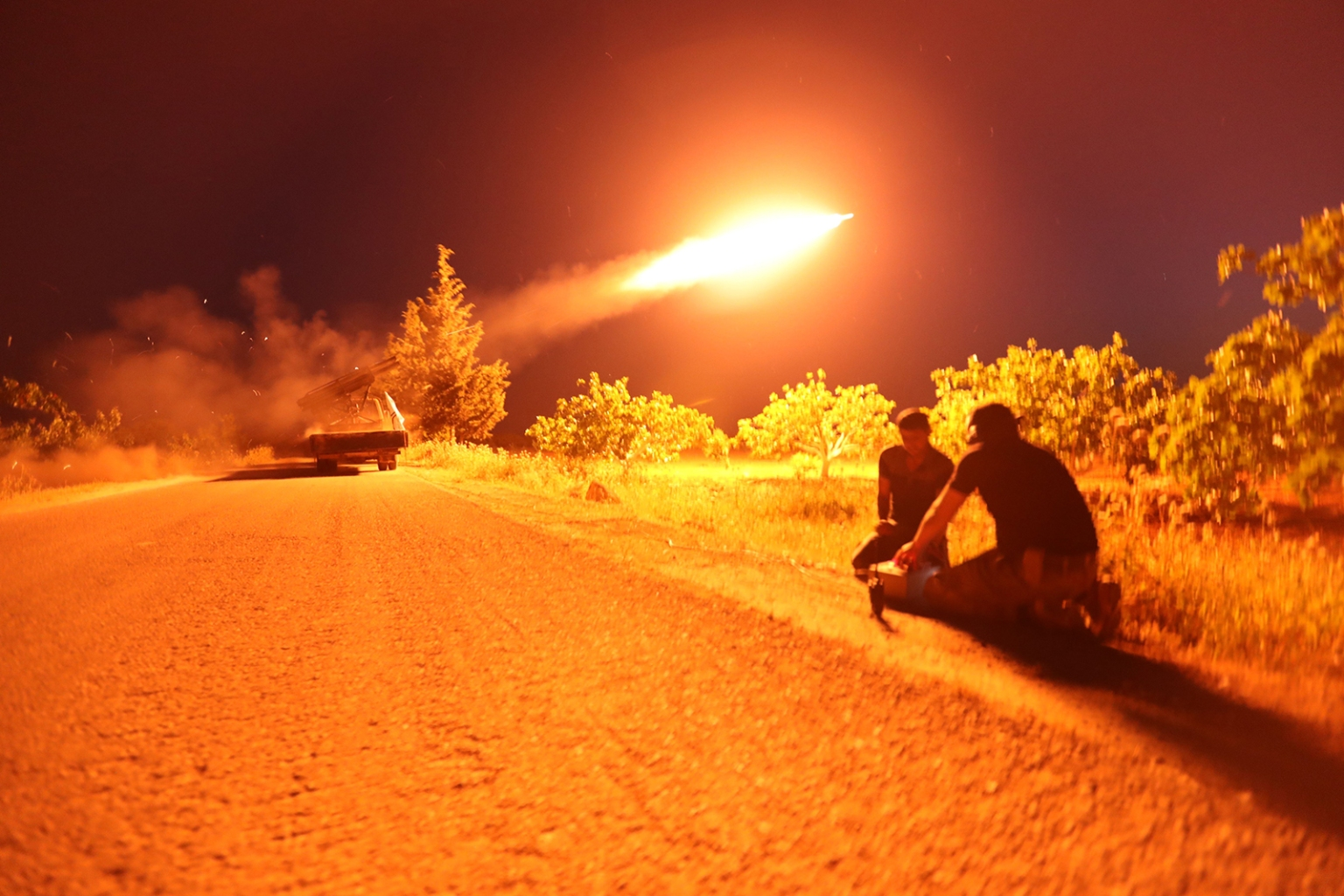 Syrian fighters from the Turkish-backed National Liberation Front fire a missile against regime positions in the rebel-held northern part of Syria's Hama province on May 13. OMAR HAJ KADOUR/AFP/Getty Images