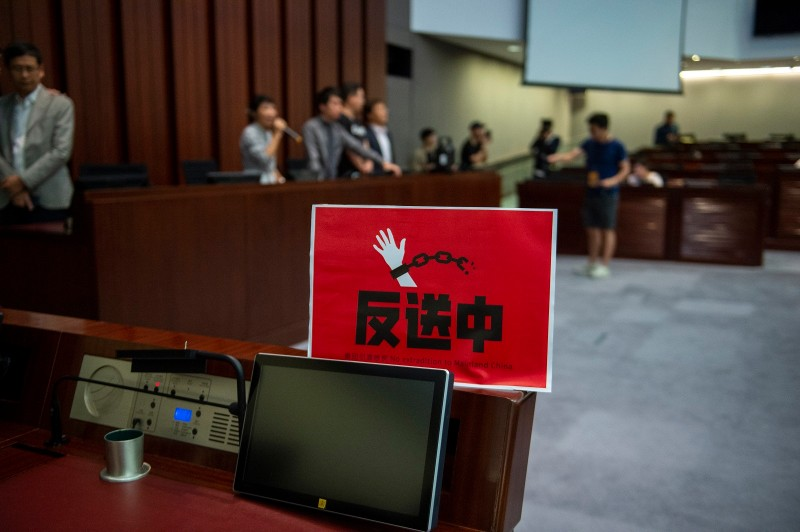 A banner against a proposed extradition law is seen in a meeting room in Hong Kong, China. 14 May 2019.